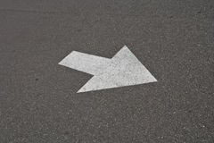 Direction Arrow. Arrow on the road indicating direction of traffic for current lane Royalty Free Stock Photo
