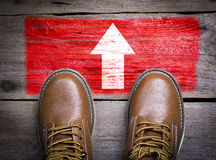 Direction Arrow. Top View of Boot on wooden background Stock Image