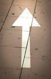 Direction arrow. On walkway on the street stock photo