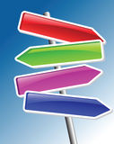 Direction arrows. Four colored direction arrows on blue Stock Photography