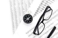 Business development concept. Direction. Compass near documents, glasses, pen on light background top view. Direction of business development concept. Compass Royalty Free Stock Photography