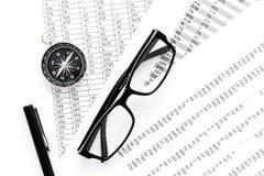 Business development concept. Direction. Compass near documents, glasses, pen on light background top view. Direction of business development concept. Compass Stock Photos