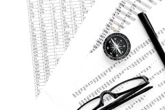 Business development concept. Direction. Compass near documents, glasses, pen on light background top view. Direction of business development concept. Compass Royalty Free Stock Photos