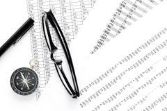 Business development concept. Direction. Compass near documents, glasses, pen on light background top view. Direction of business development concept. Compass Stock Images