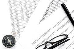 Business development concept. Direction. Compass near documents, glasses, pen on light background top view. Direction of business development concept. Compass Stock Image