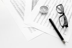 Business development concept. Direction. Compass near documents, glasses, pen on light background top view copy space. Direction of business development concept Royalty Free Stock Photos