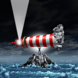 Direction Leadership. Business concept as a strong manager businessman lifting up a lighthouse from a rock island and pointing the light up as a metaphor for Royalty Free Stock Photography