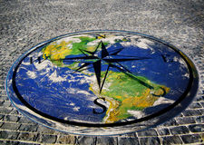 Direction map on ground with earth Stock Photos