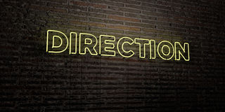 DIRECTION -Realistic Neon Sign on Brick Wall background - 3D rendered royalty free stock image Stock Image