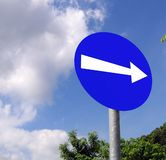 Direction Road Sign. White arrow on blue Stock Photo