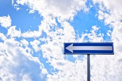 Direction road sign with cloudy sky Stock Photo