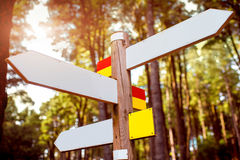 Direction road sign. Direction wooden road sign with white tables in the forest royalty free stock photo