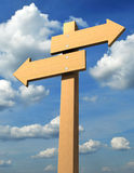 Direction sign. Wooden direction sign on sky background - 3d render Stock Photography