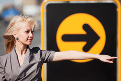 Young business woman pointing a direction Stock Photo