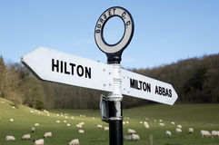 Direction Sign. In rural dorset with sheep grazing in background Stock Photography