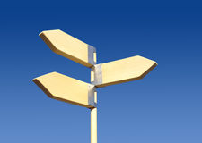 Direction sign. Wooden direction sign on blue sky with space for your text. Three directions stock image