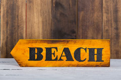 Direction sign with beach Stock Images