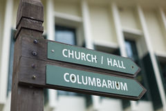 Direction sign in a Church. The sign points towards the Church Hall and the Columbarium Stock Images