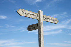 A Direction Sign for the Coast Path. A direction marker for the Coast Path, against a blue sky Stock Photos