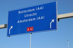 Direction sign from The Hague to Rotterdam, Amsterdam and Utrecht to motorway A12 in the Netherlands. Direction sign from The Hague to Rotterdam, Amsterdam and stock images