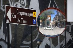Direction Sign and Reflection in the Mirror Royalty Free Stock Photography