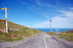 Direction sign at rural road sea view Royalty Free Stock Photo
