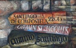 Direction sign for Santiago de Compostela. A direction sign for Santiago de Compostela, fresco by Sieger Koder on the wall of the pilgrimage house of St. James royalty free stock photos