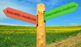 Direction sign scientific medicine - Alternative Medicine Royalty Free Stock Photography
