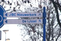 Direction sign to local jeu de boules and Hockey playing fields in Nieuwerkerk aan den IJssel in the Netherlands. Direction sign to local jeu de boules and royalty free stock images