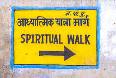 Direction sign to the spiritual walk in Pushkar. Direction sign spiritual walk assists the tourists by understanding which way to walk around the religious Royalty Free Stock Images