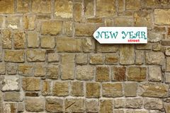 Direction Signboard  on the old stone wall Royalty Free Stock Photo