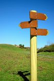 Direction signpost with arrows in park Stock Photo