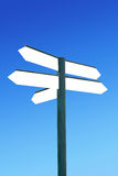 Direction signpost with blank arrows Royalty Free Stock Photography