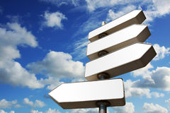 Direction signs. With cloudy blue sky in background Royalty Free Stock Photo