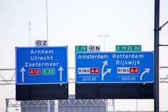 Direction signs above motorway A12 at Prins Clausplein heading Rotterdam, Amsterdam and Utrecht in the Netherlands.  royalty free stock photo