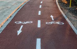 Direction signs painted on the floor of a bike lane royalty free stock photography