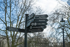 Direction signs post in Hyde Park. LONDON, UK - MARCH 14: Direction signs post in Hyde Park. March 01, 2014 in London Stock Photography