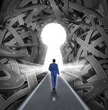 Direction Solutions. As a business leadership concept with a businessman walking to a glowing key hole shape opening as a straight path to success choosing the Stock Images