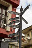 Direction to different places of the world. Indicated in a street sign. Photo taken in Veliko Tarnovo Stock Photo