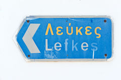 Direction to Lefkes  on Paros island. Sign to Lefkes on typical Greek white stucco house Royalty Free Stock Photography