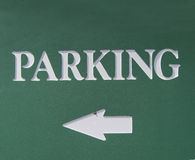 Direction to the parking. Picture of the  board with arrow directed to the parking Stock Image