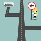 Direction to success version2. Road and businesswoman carry traffic sign go to success Stock Photos