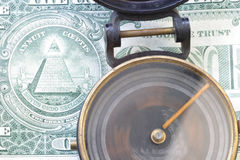 Direction & $ US dollar 3485 Spinning compass, one dollar bill. Direction& the dollar. A spinning compass and a part of the back of a one dollar bill close-up Stock Image