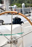 Direction wheel and bollard of yacht Stock Photo