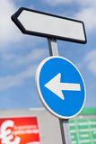 Direction and white sign Stock Images