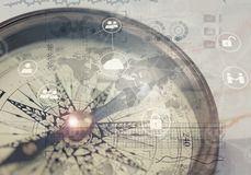A direction of your success. A compass and financial charts Stock Photography