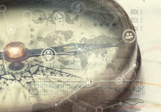 A direction of your success. A compass and financial charts Stock Images