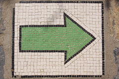 Directional arrow. From small stones in green Royalty Free Stock Images