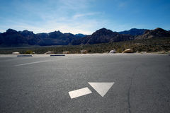 Directional arrow. Directional arrow on the empty parking lot in Mojave Desert, Nevada Stock Photos