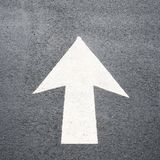 Directional Arrow. On pavement with copy space royalty free stock images
